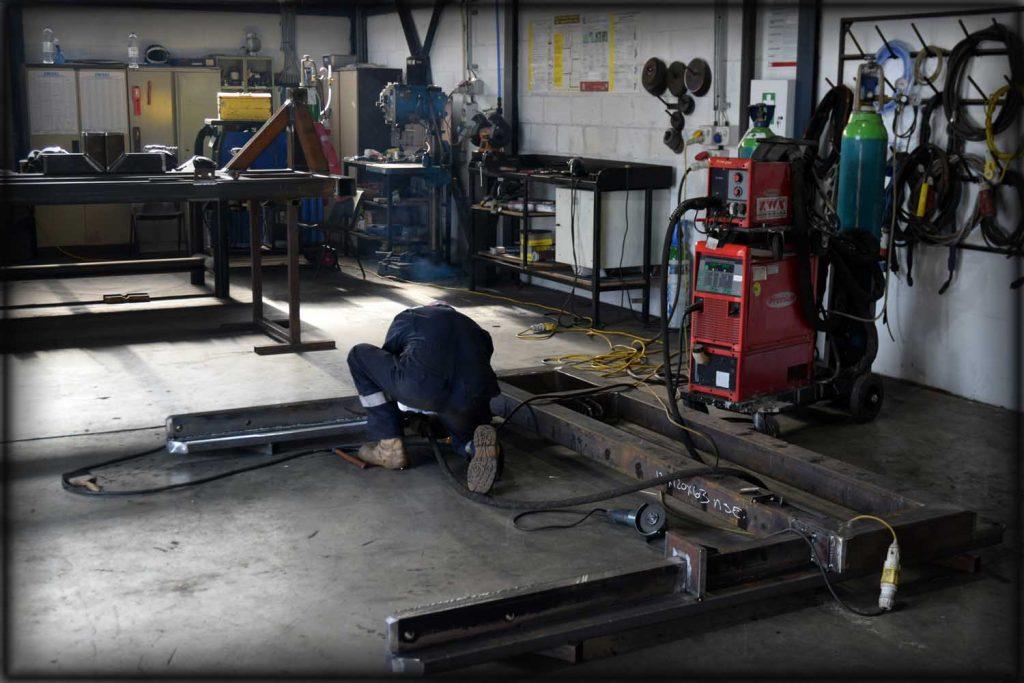 Welder welding structural steel
